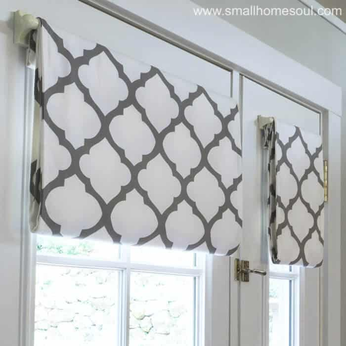 Closeup of simple french door curtains opened.