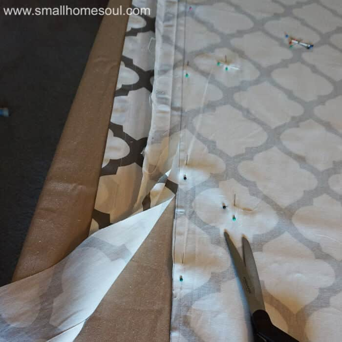 Cutting the panels for simple french door curtains.