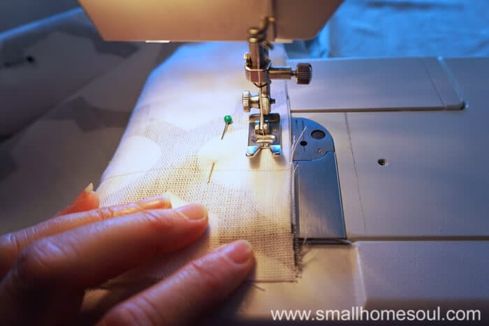 Stitching the simple french door curtain panels together.