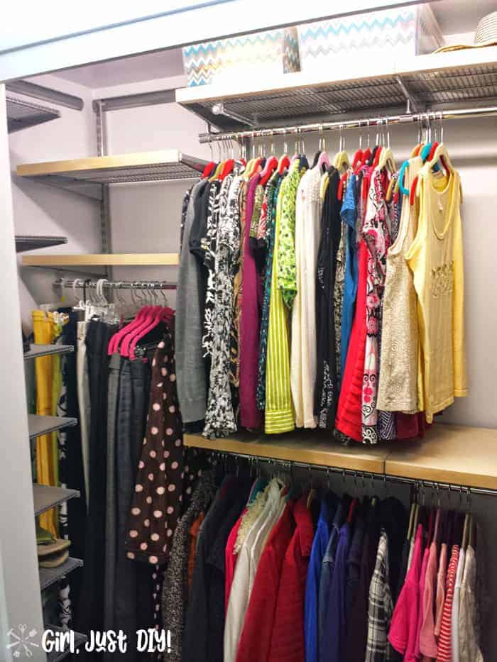 Left view with female clothes hung after closet makeover but empty shelves.