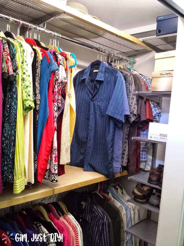 Man's clothes hung on right side after closet makeover.