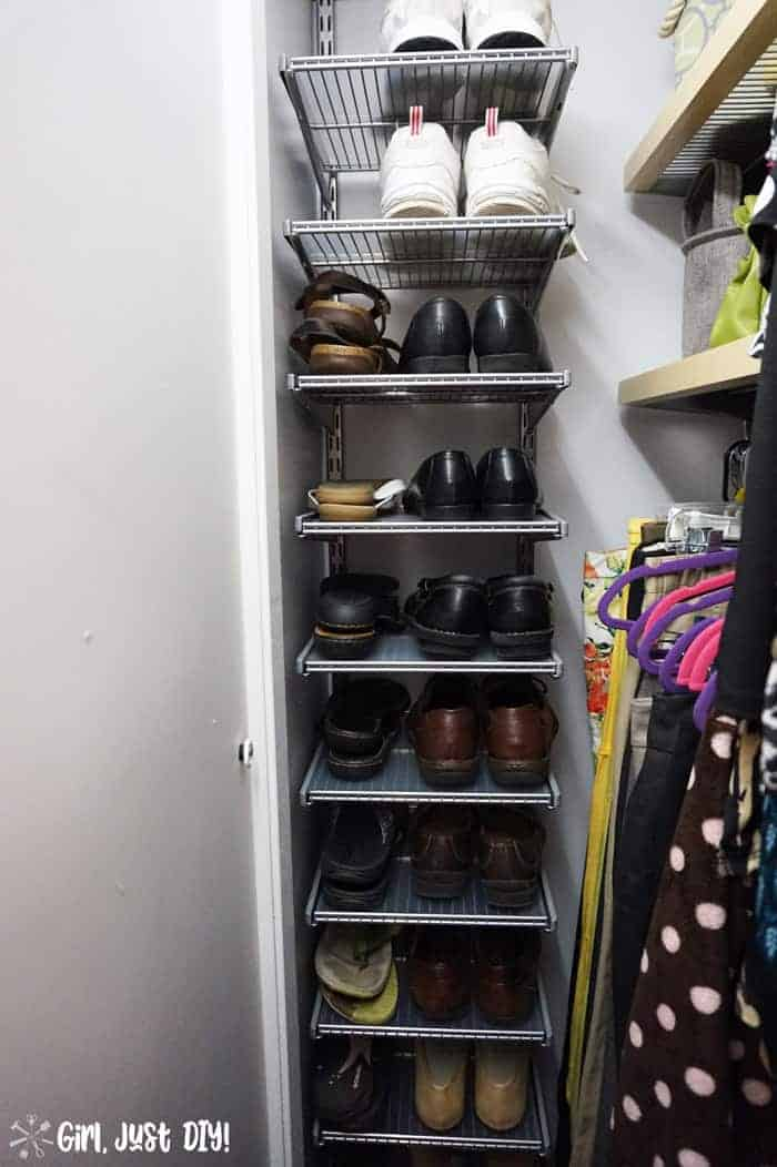 Shoes on vertical shelves added during closet makeover.