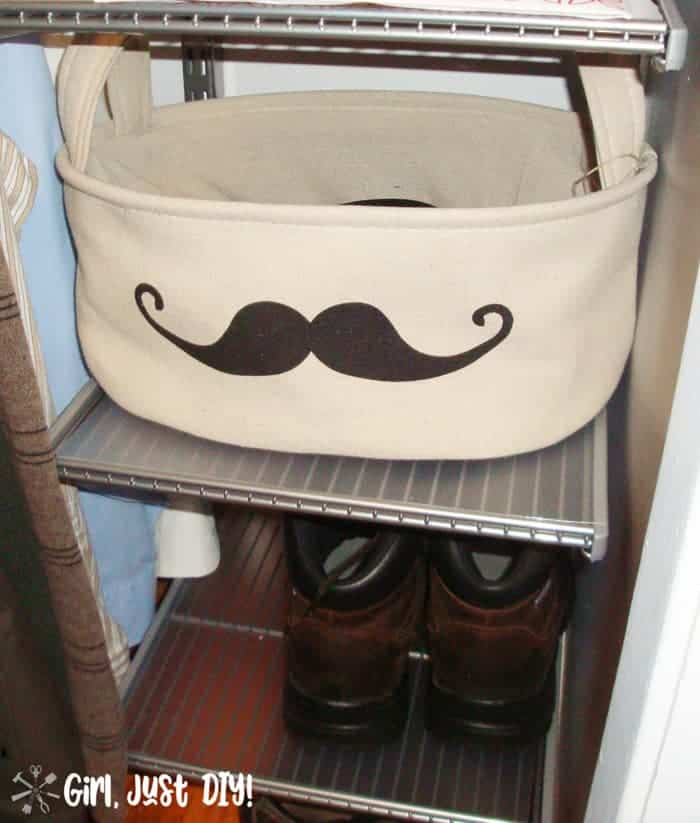 Fabric basket with mustache image on shoe shelf after closet makeover.