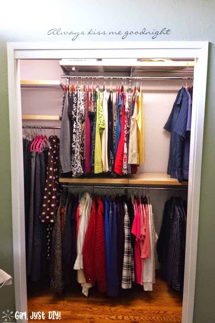 Closet after elfa system installed and clothes hung but shelves still empty.