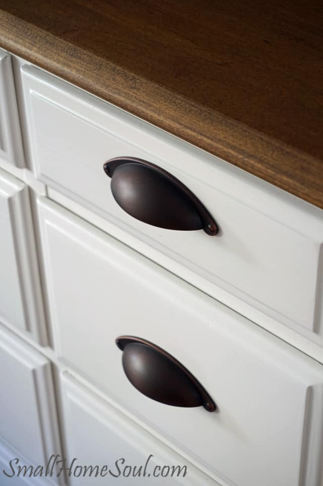 closeup of TV Console top and drawer pulls