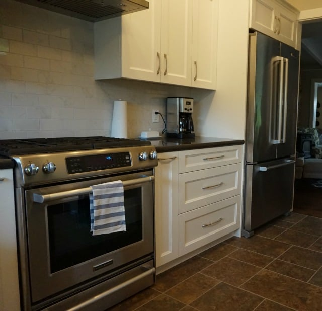 Kitchen Renovation completed, new slide in range and refrigerator.