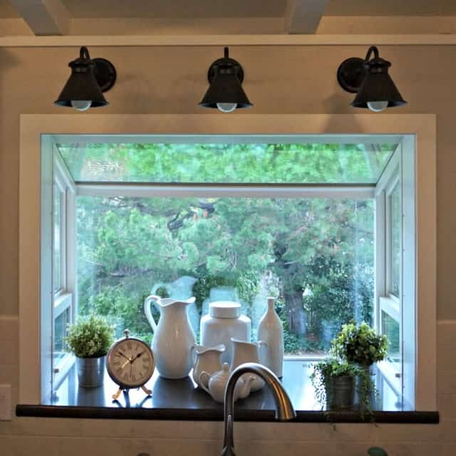 closeup of garden window and goose neck lights in completed Kitchen Renovation.