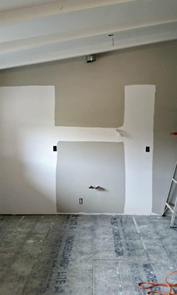 Painting kitchen walls gray before kitchen installation begins