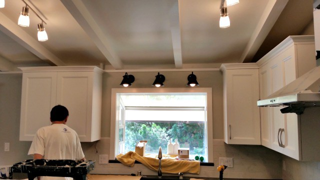 New Gooseneck lights installed over kitchen sink.