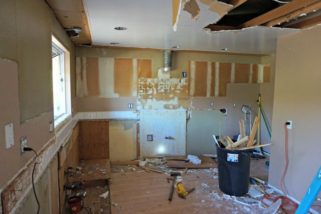 Kitchen demo underway, ceiling coming down and all cabinets gone.