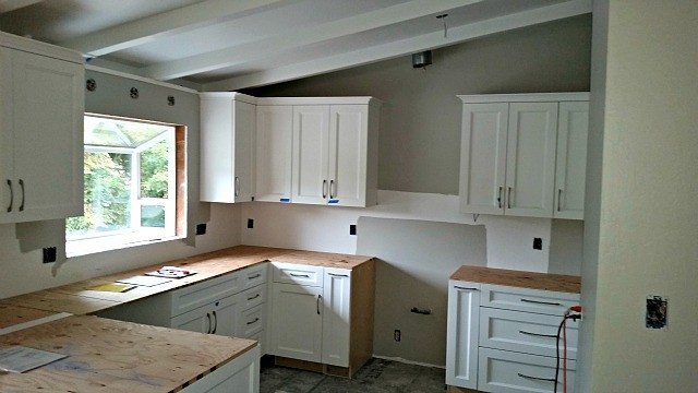New cabinets installed and plywood counter top under layment.
