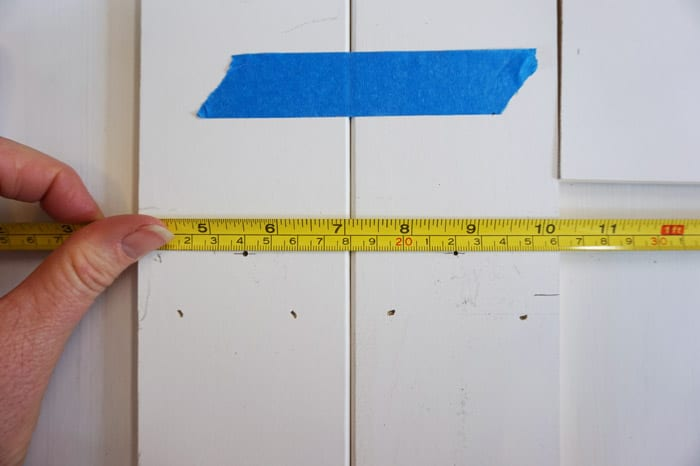 Ruler measuring center of trim boards