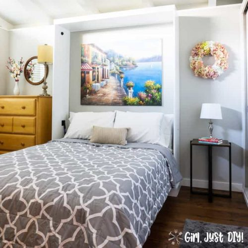Opened murphy bed with bed linens