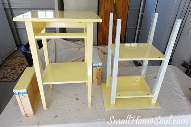 Hacked Ikea Nightstands with buttery yellow paint and new drawer pulls that play off the comforter - www.smallhomesoul.com
