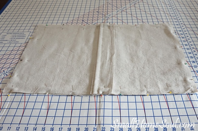 Making a stenciled drop cloth pillow cover is easy with this detailed tutorial. You can make one too in just a few hours. www.smallhomesoul.com