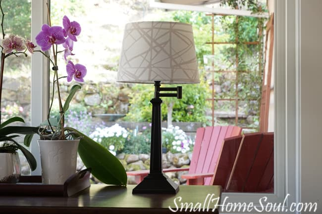 """A $2 thrifted Swing Arm Lamp and a $4 clearance shade make for a beautiful """"new"""" lamp - www.smallhomesoul.com"""