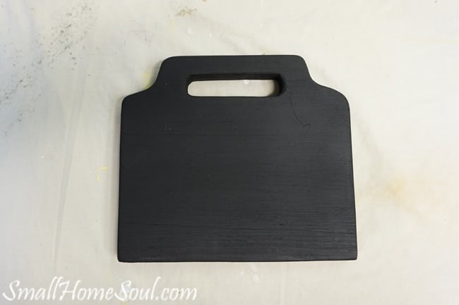 Black painted board for the mason jar utensil caddy.