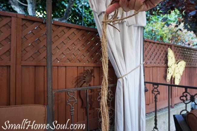 holding twisted jute twine for tiebacks for drop cloth curtains
