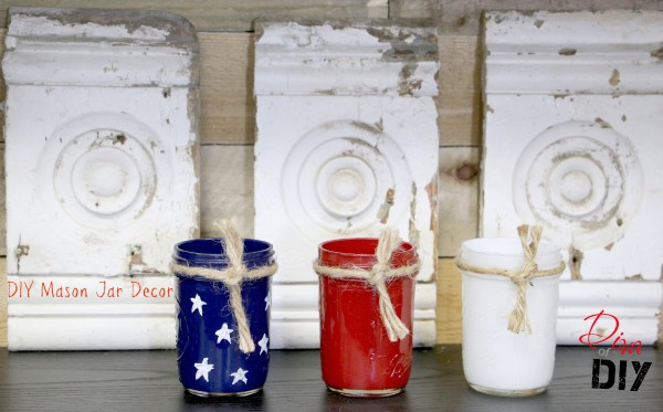 Red white and blue painted pint size mason jars in front of wood detail.
