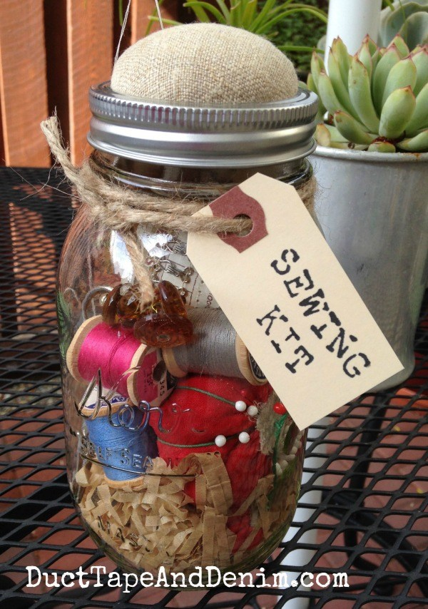 Quart mason jar filled with thread spools and sewing supplies