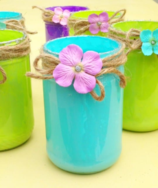 Sea blue, lime green and purple painted pint mason jars with jute twine bows.