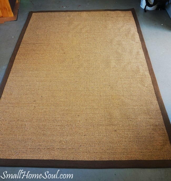 Before Painting a seagrass rug it's just a boring brown rug.