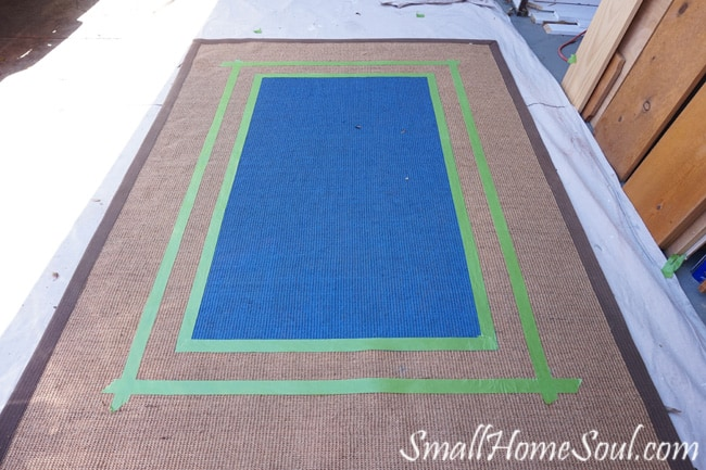 Adding another taped border to the seagrass rug.