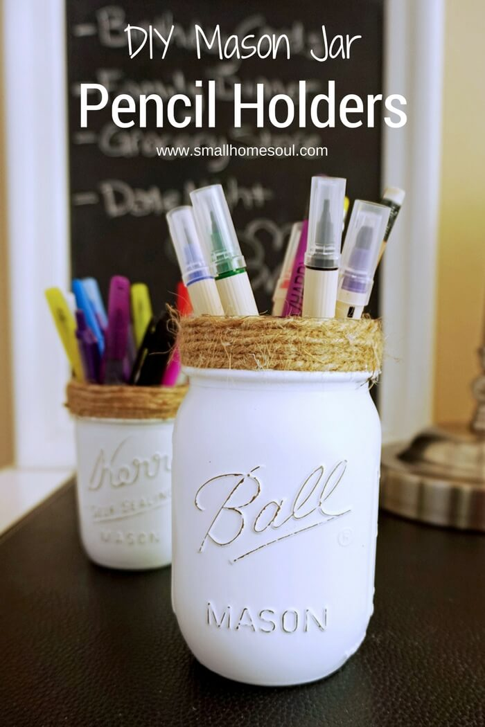 Mason jar pencil holders in front of chalkboard