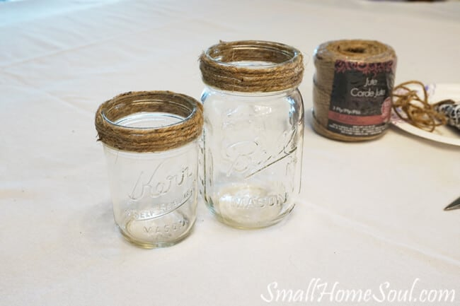 mason jars wrapped with jute twine at top.