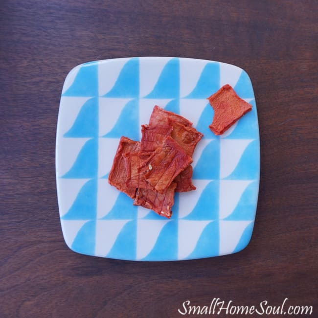 pile of watermelon candy on a blue and white plate