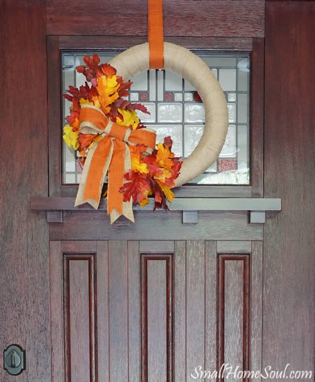 DIY Fall Wreath hanging on brown front door.