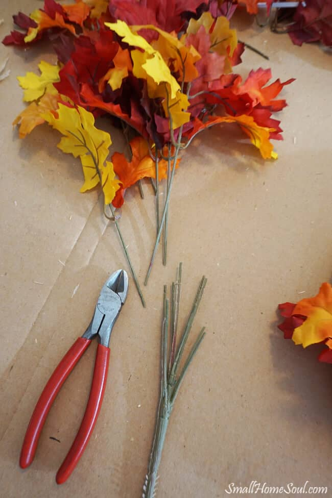 Faux maple leaf stems and wire cutters.