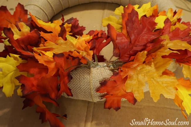 Maple leaf faux stems glued into wreath form.