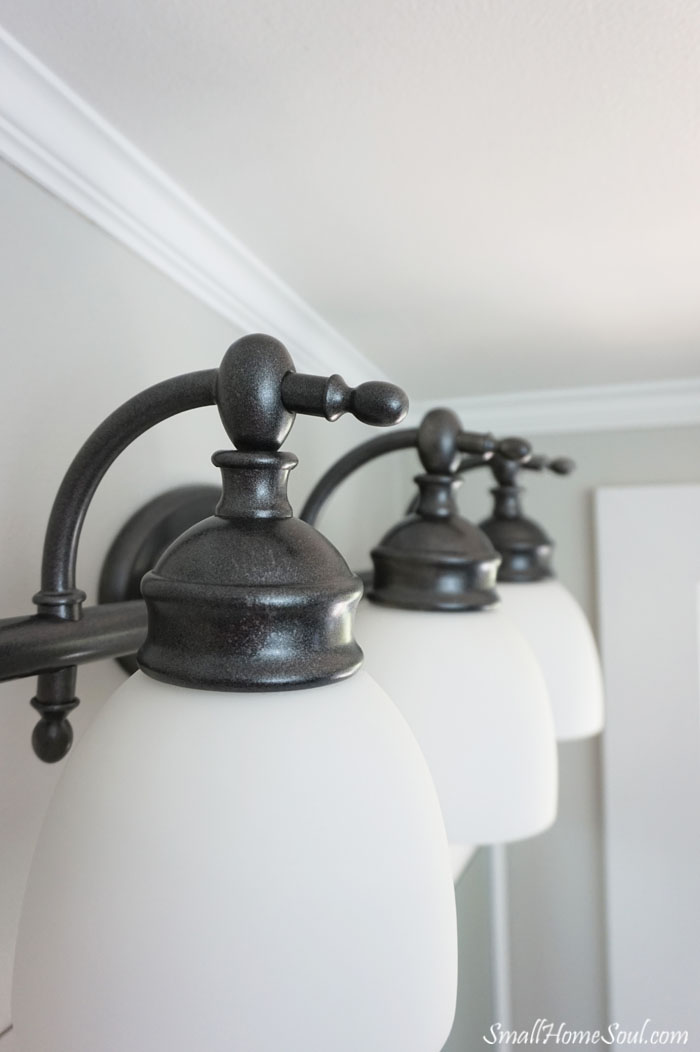 Check out this beautiful light update with spray paint from a Master Bathroom Makeover!