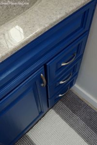 Love the new Indigo color on this cabinet. You have to see this beautiful Master Bathroom Makeover completed for less than $100!