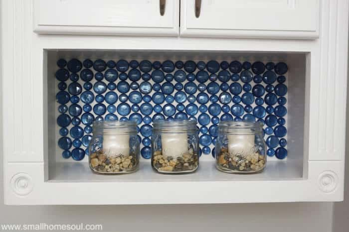 Wow, this beautiful glass backsplash was made with paint and Dollar Store beads. It's lovely, I'm stealing this idea!