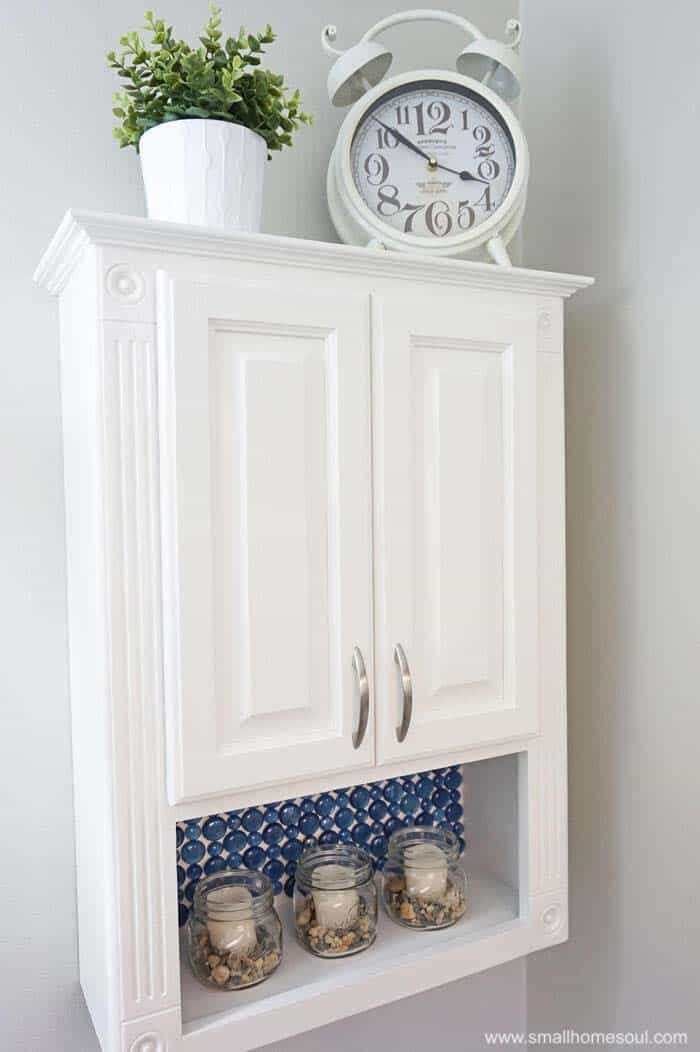 TP cabinet on wall with blue glass backsplash!