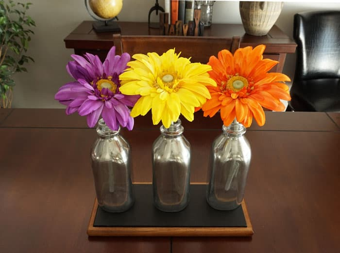 These mirrored milk bottles work beautifully as unique centerpiece! www.smallhomesoul.com