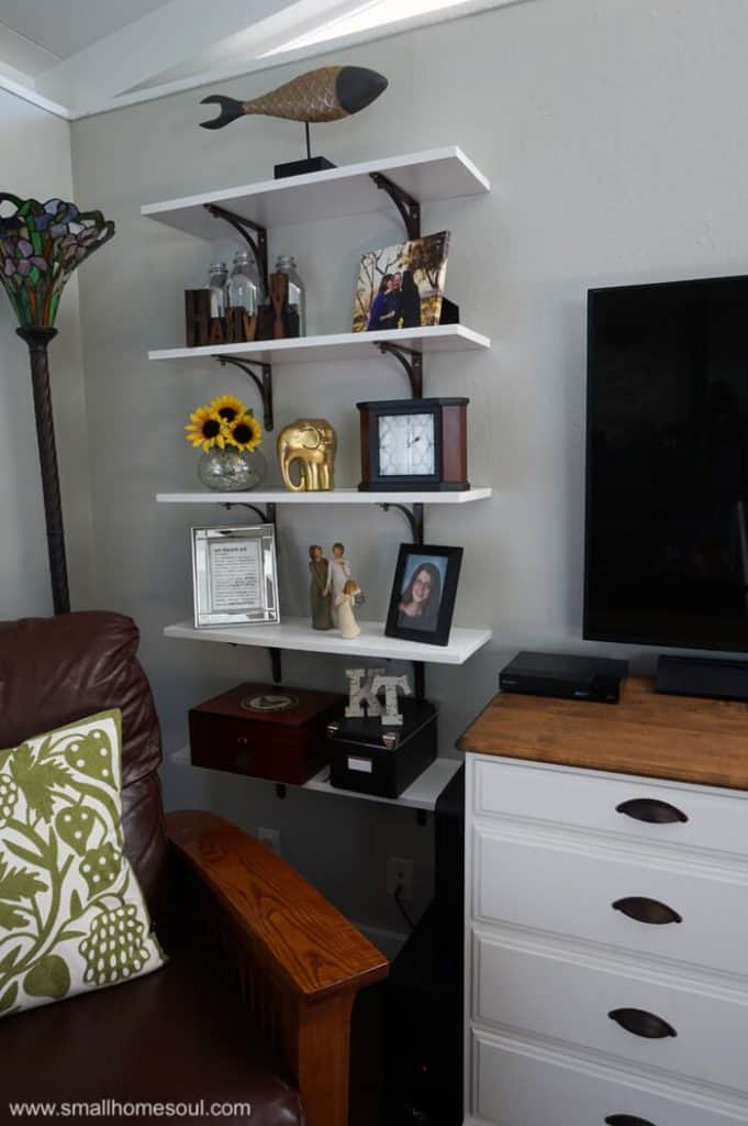 One set of shelves to the left of the TV