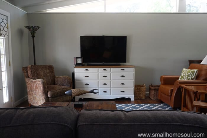 white dresser and tv on wall of living room