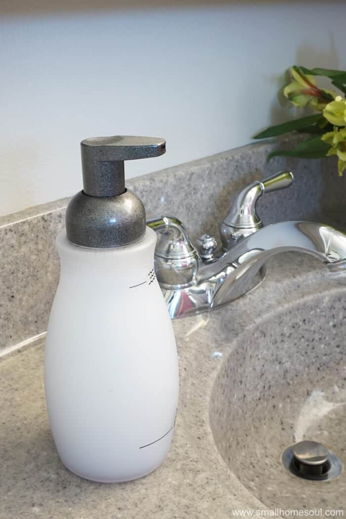Updated foaming soap dispenser next to sink