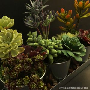 This faux succulent planter is so beautiful in galvanized pots.