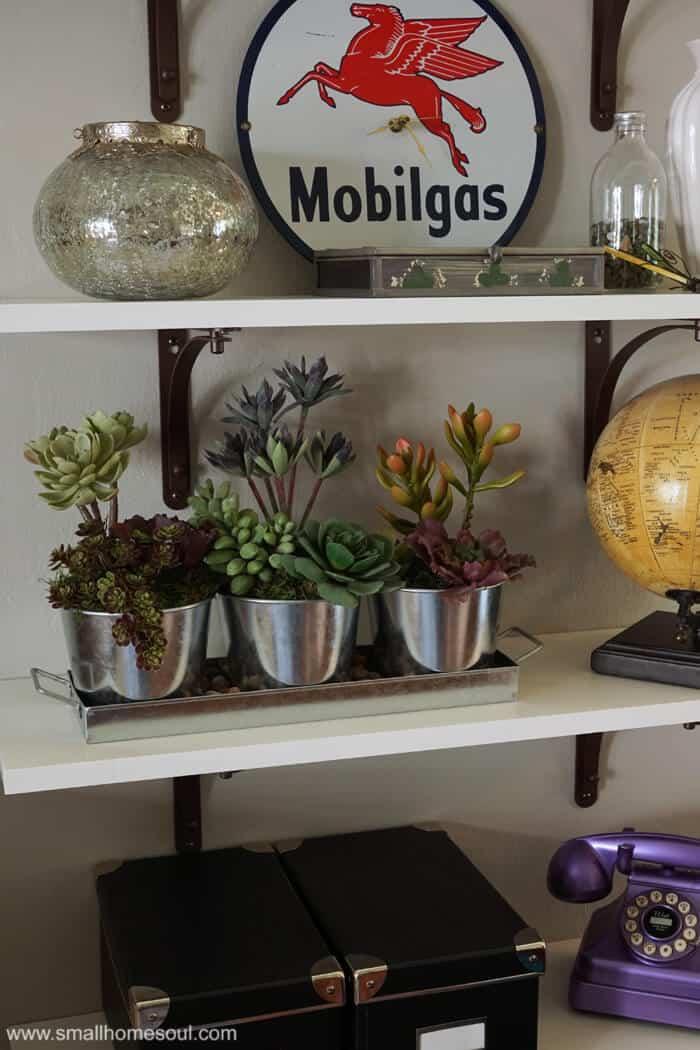 This faux succulent planter is so beautiful galvanized pots.