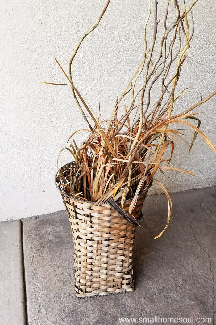 Crusty basket from yard sale ready to become an outdoor plant stand.