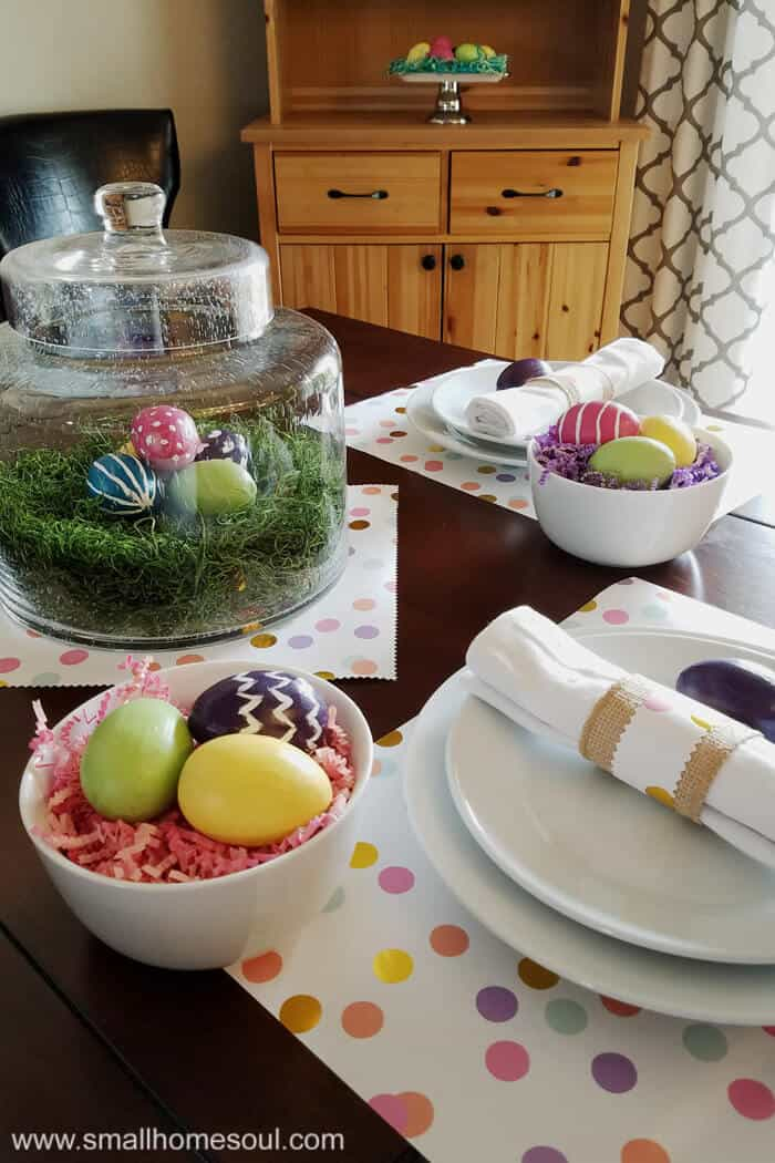 Easter table decorations including painted easter eggs on table set for two.