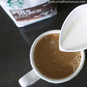Adding cream to my favorite coffee.