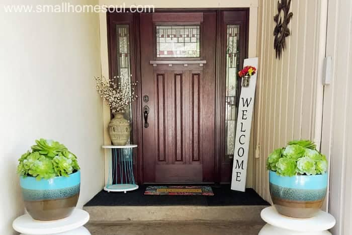 Wide shot of porch with diy welcome sign in corner.