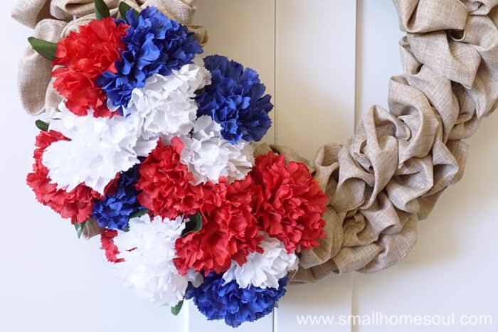 Bunches of carnations make the July 4th Wreath pop.