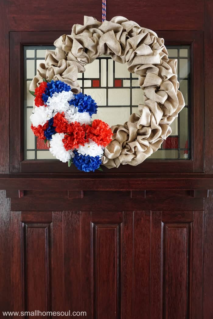 July 4th wreath hung on the front door for 4th of July.