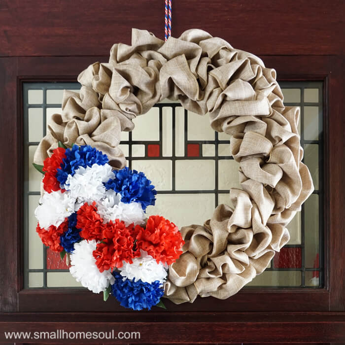 Closeup of July 4th Wreath hung on front door for 4th of July.